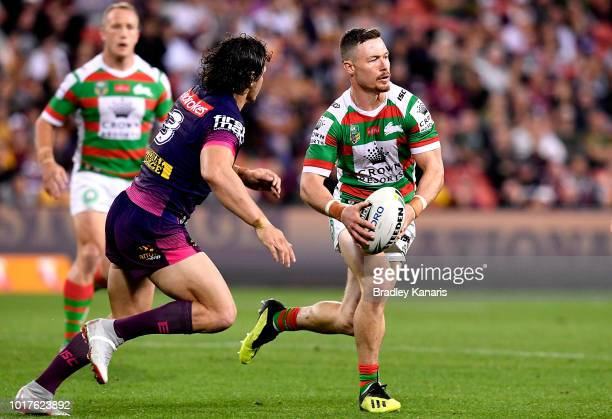 Damien Cook of the Rabbitohs runs with the ball during the round 23 NRL match between the Brisbane Broncos and the South Sydney Rabbitohs at Suncorp...