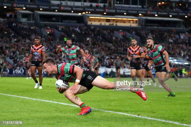 Damien Cook of the Rabbitohs scores a try during the round 11 NRL match between the South Sydney Rabbitohs and the Wests Tigers at ANZ Stadium on May...
