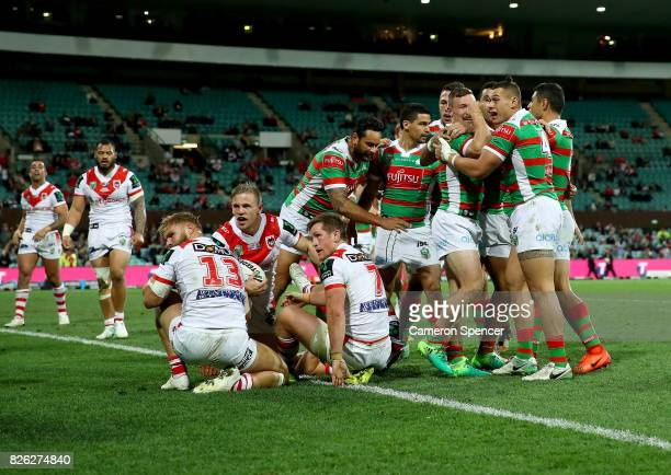 Damien Cook of the Rabbitohs scores a try during the round 22 NRL match between the St George Illawarra Dragons and the South Sydney Rabbitohs at...