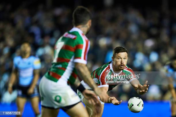 Damien Cook of the Rabittohs looks to pass the ball during the round 20 NRL match between the Cronulla Sharks and the South Sydney Rabbitohs at Shark...