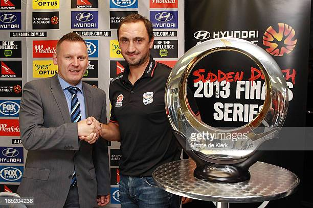Damien de Bohun Head of Hyundai ALeague and Michael Valkanis coach of Adelaide pose for a photo during the Adelaide United ALeague 2013 Finals Series...