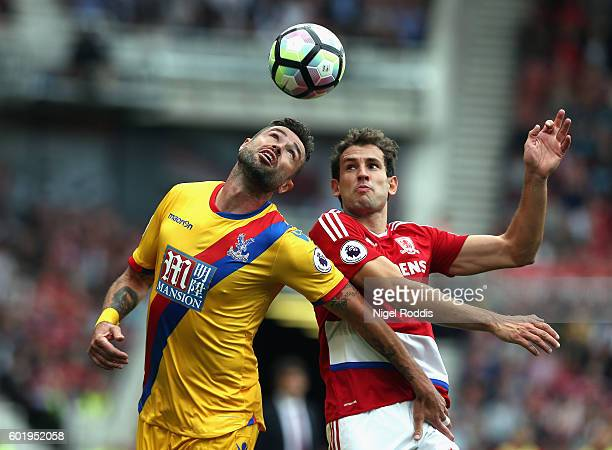 Damien Delaney of Crystal Palace and Cristhian Stuani of Middlesbrough battle for possession during the Premier League match between Middlesbrough...