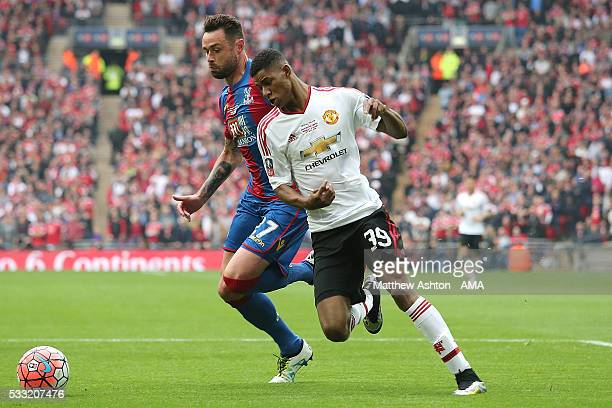 Damien Delaney of Crystal Palace battles with Marcus Rashford of Manchester United during The Emirates FA Cup final match between Manchester United...