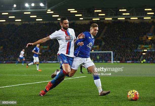 Damien Delaney of Crystal Palace challenges Gerard Deulofeu of Everton during the Barclays Premier League match between Everton and Crystal Palace at...