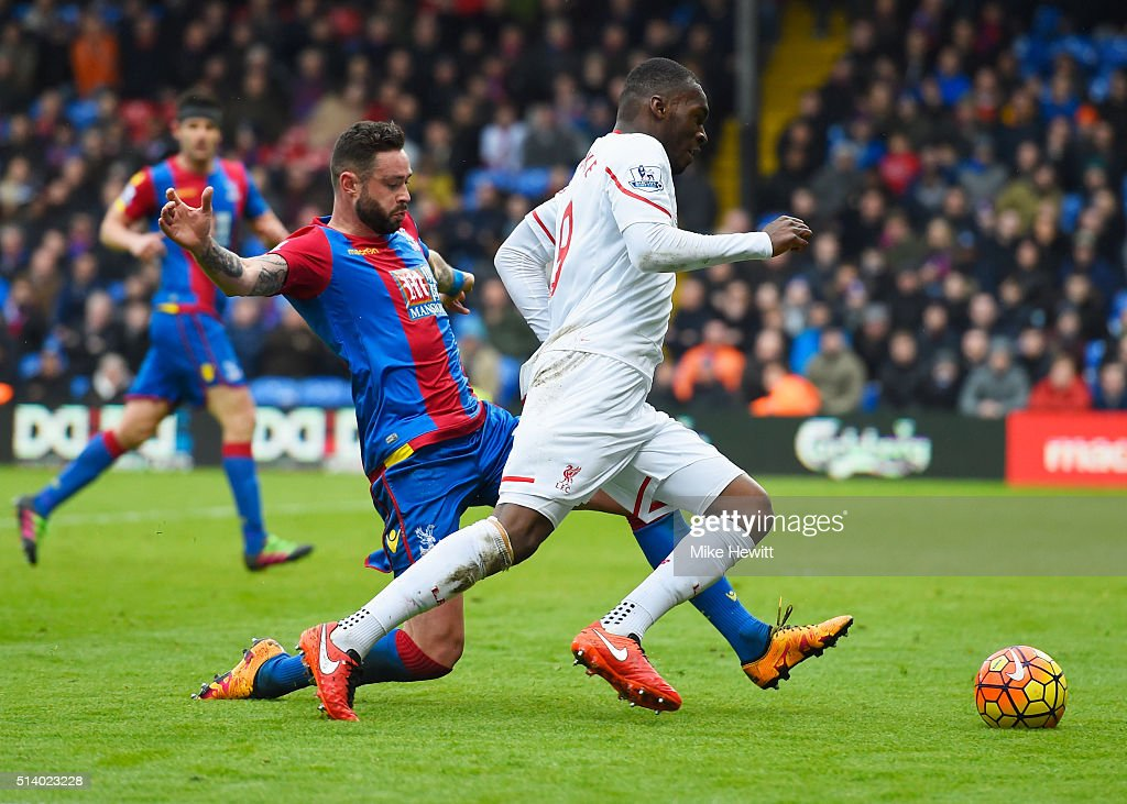 Damien Delaney of Crystal Palace fouls Christian Benteke of Liverpool to concede a penalty during the Barclays Premier League match between Crystal Palace and Liverpool at Selhurst Park on March 6, 2016 in London, England.