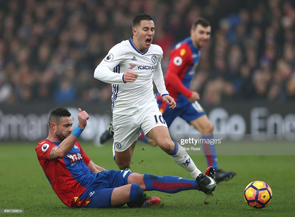 Damien Delaney of Crystal Palace (L) fouls Eden Hazard of Chelsea (R) during the Premier League match between Crystal Palace and Chelsea at Selhurst Park on December 17, 2016 in London, England.