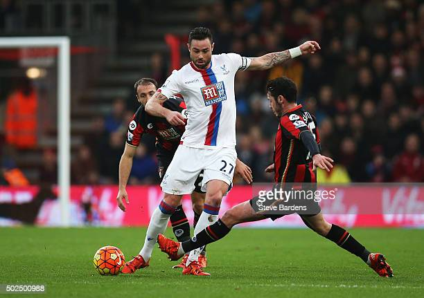 Damien Delaney of Crystal Palace is closed down by Adam Smith of Bournemouth during the Barclays Premier League match between AFC Bournemouth and...