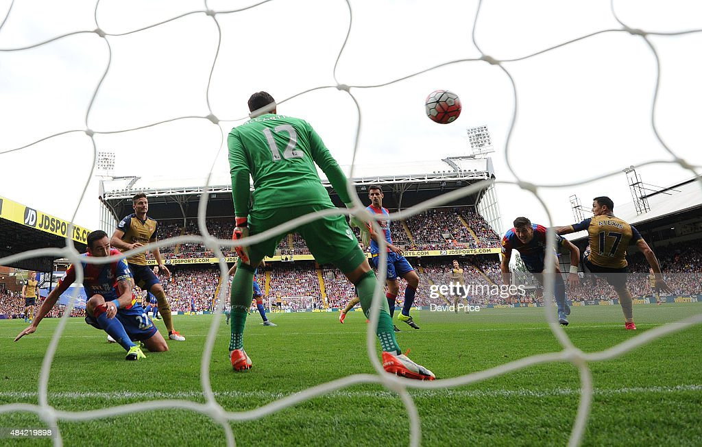 Damien Delaney of Crystal Palace scores an own goal following a header from Alexis Sanchez of Arsenal during the Barclays Premier League match between Crystal Palace and Arsenal on August 16, 2015 in London, United Kingdom.