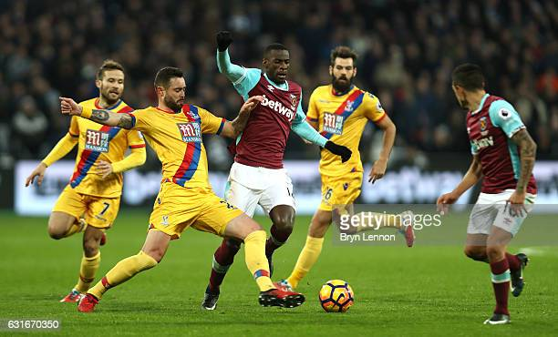 Damien Delaney of Crystal Palace tackles Pedro Obiang of West Ham United during the Premier League match between West Ham United and Crystal Palace...