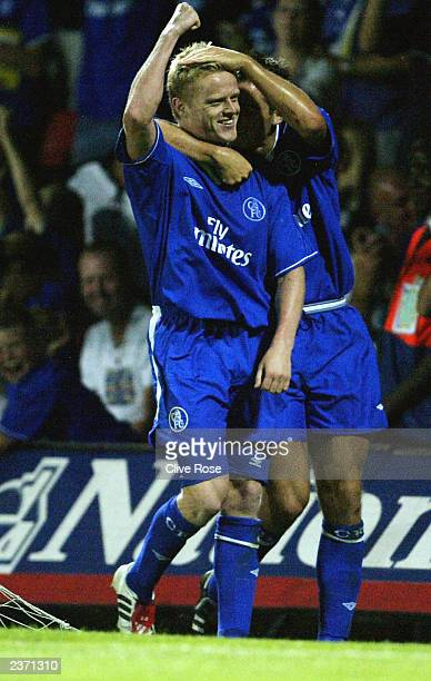 Damien Duff of Chelsea celebrates with Frank Lampard after scoring during the preseason friendly match between Watford and Chelsea on August 5 2003...
