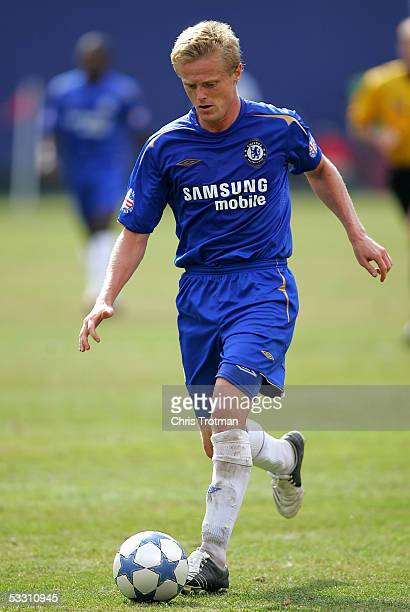 Damien Duff of Chelsea FC drives against AC Milan during their World Series of Football friendly match at Giants Stadium on July 31, 2005 in East...