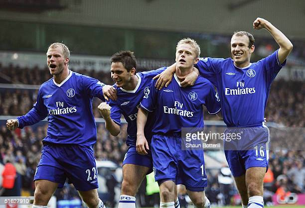 Damien Duff of Chelsea is congratulated by team-mates Eidur Gudjohnsen, Frank Lampard and Arjen Robben after scoring during the Barclays Premiership...