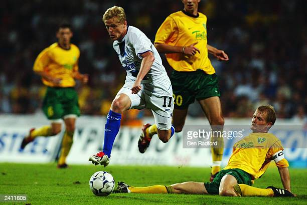 Damien Duff of Chelsea takes the ball past Branislav Labant of MSK Zilina during the UEFA Champions League qualifying round first leg match held on...