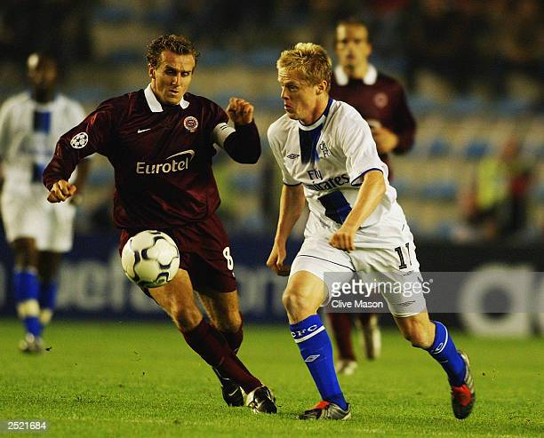 Damien Duff of Chelsea takes the ball past Karel Poborsky of AC Sparta Prague during the UEFA Champions League Group G match between AC Sparta Prague...