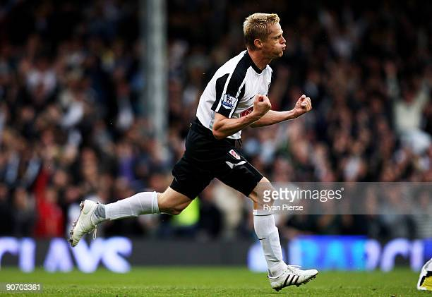 Damien Duff of Fulham celebrates after scoring to give his team a 21 lead during the Barclays Premier League match between Fulham and Everton at...