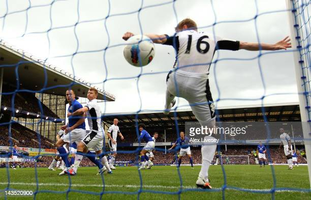 Damien Duff of Fulham is beaten on the line by a header from Marouane Fellaini of Everton for the second goal during the Barclays Premier League...
