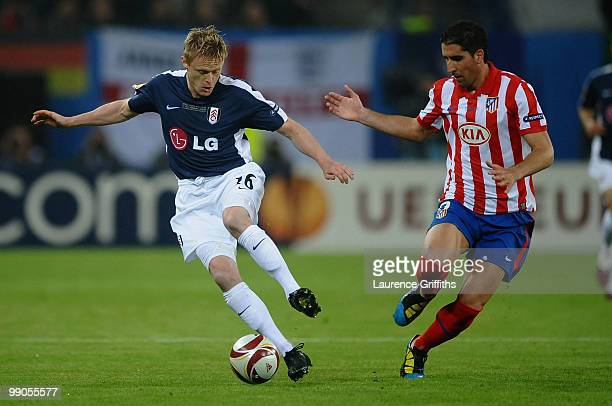 Damien Duff of Fulham is challenged by Raul Garcia of Atletico Madrid during the UEFA Europa League final match between Atletico Madrid and Fulham at...