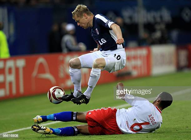 Damien Duff of Fulham plays the ball over Dennis Aogo of HSV during the UEFA Europa League semi final first leg match between Hamburger SV and Fulham...