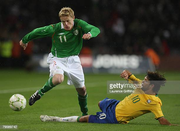 Damien Duff of Ireland skips past Diego Ribas of Brazil during the International Friendly Match between Ireland and Brazil at Croke Park on February...