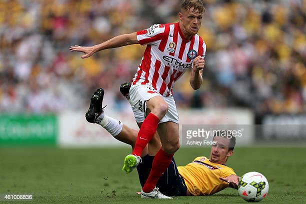 Damien Duff of Melbourne City contests the ball against Jacob Poscoliero of the Mariners during the round 15 ALeague match between the Central Coast...