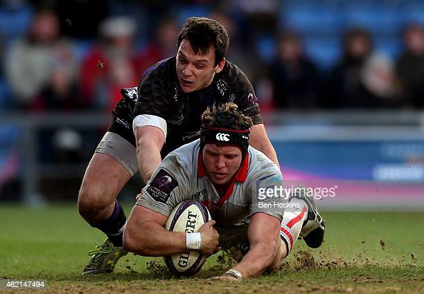 Damien Fitzpatrick of Lyon scores a try under pressure from James Lewis of London Welsh during the European Rugby Challenge Cup match between London...