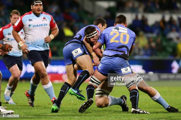 Damien Fitzpatrick of the Waratahs is tackled by Richard Hardwick of the Force during the round 17 Super Rugby match between the Force and the...