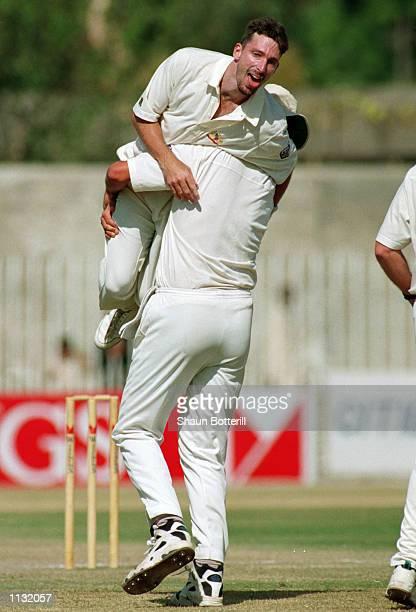 Damien Fleming of Australia celebrates his hattrick after taking the wicket of Saleem Malik of Pakistan during the 2nd Test Match at the Rawalpindi...
