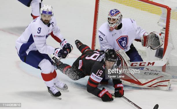 Damien Fleury and Henri-Corentin Buysse of France in action with Captain Kyle Turris of Canada during the 2019 IIHF Ice Hockey World Championship...
