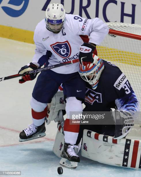Damien Fleury of France battle the puck over Thatcher Demko of USA during the 2019 IIHF Ice Hockey World Championship Slovakia group A game between...