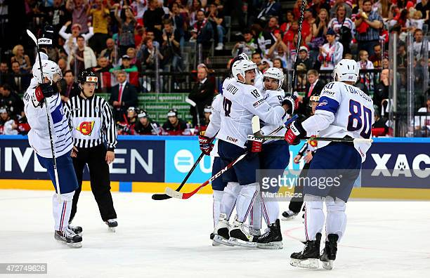 Damien Fleury of France celebrate with his tea mmates after scoring the equalizing goal during the IIHF World Championship group A match between...
