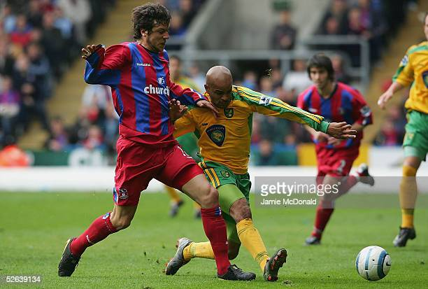 Damien Francis of Norwich is tackled by Gonzalo Sorondo of Palace during the Barclays Premiership match between Crystal Palace and Norwich City at...