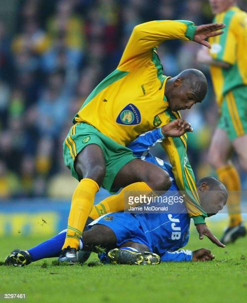Damien Francis of Norwich is tackled by Nathan Ellington of Wigan during the Nationside Division One match between Norwich City and Wigan Athletic at...