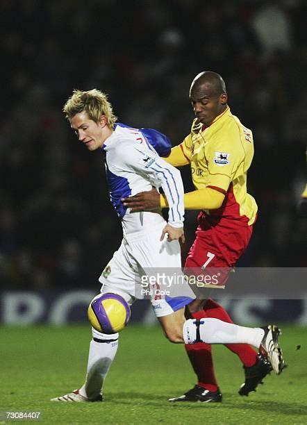 Damien Francis of Watford tackles Morten Gamst Pedersen of Blackburn Rovers during the Barclays Premiership match between Watford and Blackburn...