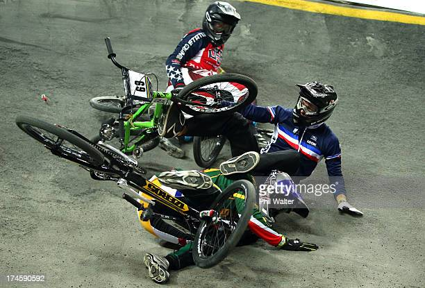 Damien Godet of France and Sifiso Nhlapo of South Africa crash out during day five of the UCI BMX World Championships at Vector Arena on July 28 2013...