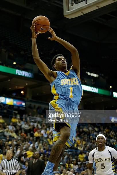 Damien Goodwin of the Southern Jaguars drives to the hoop during the second half against the Marquette Golden Eagles during the game at BMO Harris...