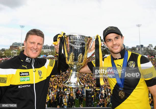 Damien Hardwick and Trent Cotchin of the Tigers hold up the Premiership Trophy after winning yesterday's AFL Grand Final at Punt Road Oval on October...