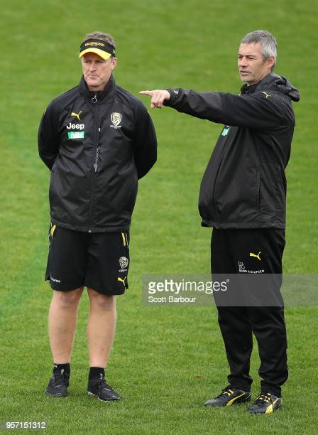 Damien Hardwick coach of the Tigers and Blake Caracella assistant coach of the Tigers talk during a Richmond Tigers AFL training session at Punt Road...