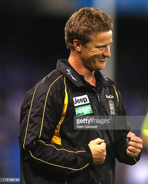 Damien Hardwick coach of the Tigers celebrates his teams win in the round five AFL match between the North Melbourne Kangaroos and the Richmond...