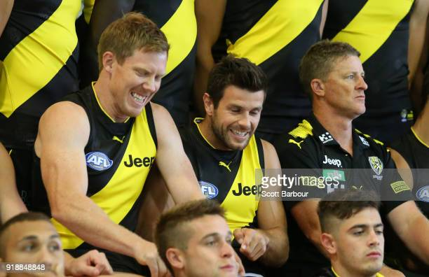 Damien Hardwick coach of the Tigers Jack Riewoldt of the Tigers and Trent Cotchin of the Tigers look on during a Richmond Tigers AFL team photo...