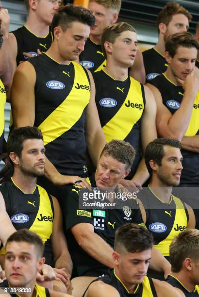 Damien Hardwick coach of the Tigers recieves a massage from Ivan Soldo during a Richmond Tigers AFL team photo session at Punt Road Oval on February...