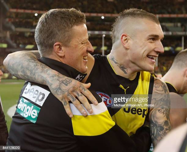 Damien Hardwick Senior Coach of the Tigers and Dustin Martin of the Tigers celebrate during the AFL Second Qualifying Final Match between the Geelong...