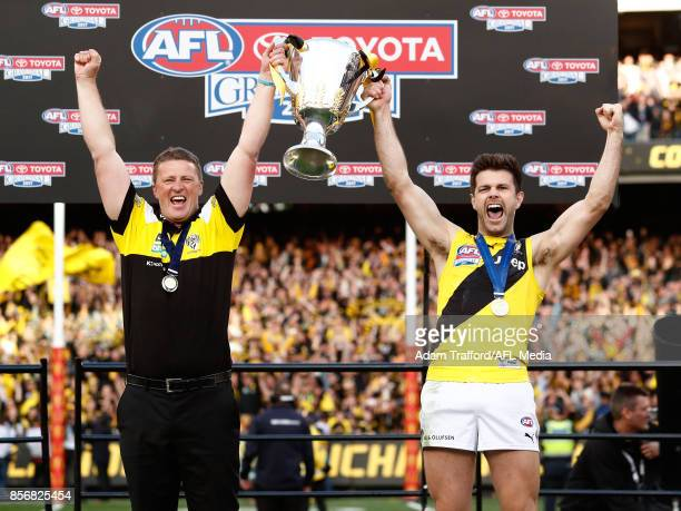 Damien Hardwick Senior Coach of the Tigers and Trent Cotchin of the Tigers hold up the premiership cup during the 2017 Toyota AFL Grand Final match...