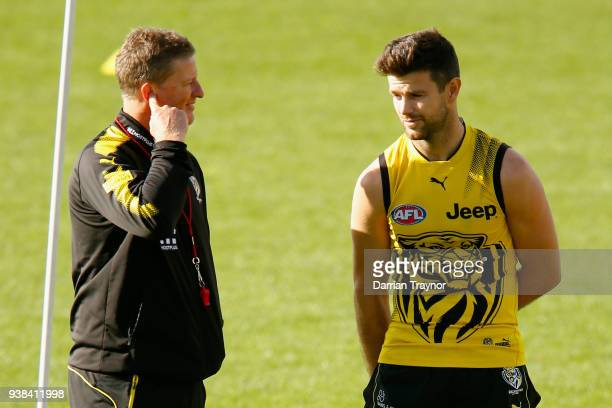 Damien Hardwick, Senior Coach of the Tigers speaks with captain Trent Cotchin during a Richmond Tigers AFL training session at Punt Road Oval on...