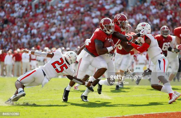Damien Harris of the Alabama Crimson Tide breaks a tackle by Sherman Coleman of the Fresno State Bulldogs for a touchdown at BryantDenny Stadium on...