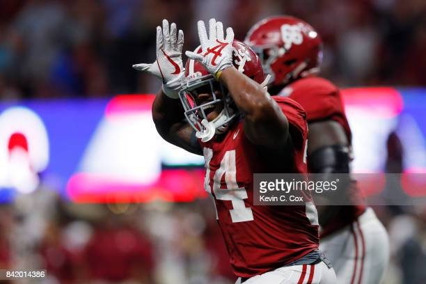 Damien Harris of the Alabama Crimson Tide celebrates a touchdown in the third quarter of their game against the Florida State Seminoles at...