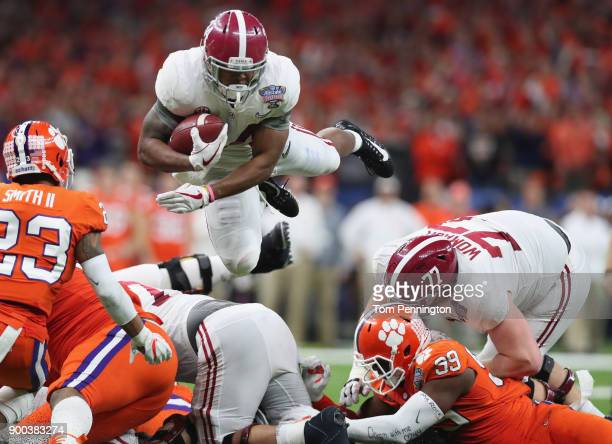Damien Harris of the Alabama Crimson Tide dives with the ball as Van Smith of the Clemson Tigers defends in the second half of the AllState Sugar...