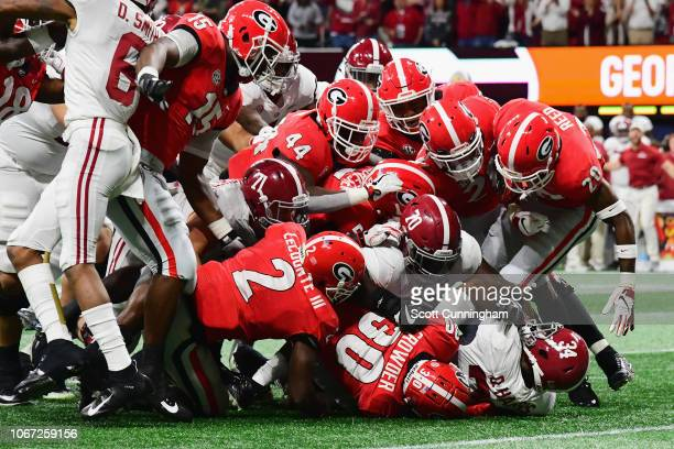 Damien Harris of the Alabama Crimson Tide is tackled by the Georgia Bulldogs defense in the first half during the 2018 SEC Championship Game at...