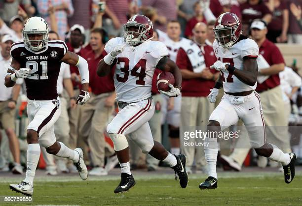 Damien Harris of the Alabama Crimson Tide runs 75 yards for a touchdown in the first quarter as Charles Oliver of the Texas AM Aggies is unable to...