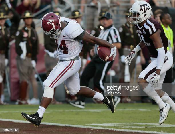 Damien Harris of the Alabama Crimson Tide runs away from Charles Oliver of the Texas AM Aggies for a 75 yard touchdown in the first quarter at Kyle...