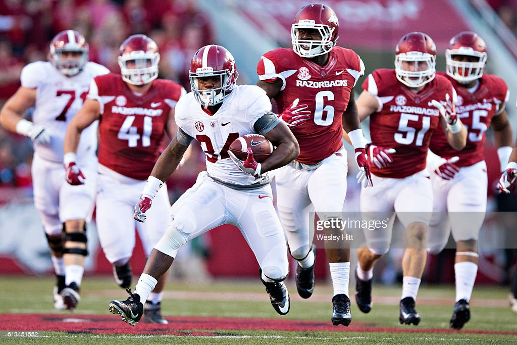 Damien Harris #34 of the Alabama Crimson Tide runs the ball during a game against the Arkansas Razorbacks at Razorback Stadium on October 8, 2016 in Fayetteville, Arkansas. The Crimson Tide defeated the Razorbacks 49-30.